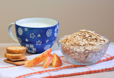 Bowl of oatmeal, apple, milk, crackers Stock Photo