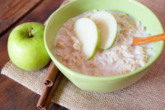 Oatmeal with apples. Bowl of oatmeal with apples Royalty Free Stock Image