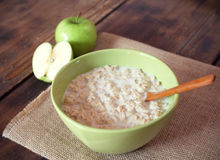 Oatmeal with apples. Bowl of oatmeal with apples Royalty Free Stock Photos
