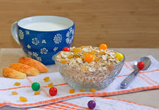 Bowl of oatmeal cereal with candies, apples, milk Royalty Free Stock Photography