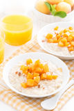 Bowl of oatmeal with fresh apricots and orange juice Royalty Free Stock Image