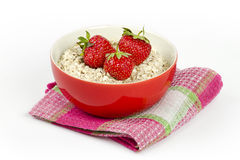 Bowl with oatmeal and fresh strawberries Royalty Free Stock Image