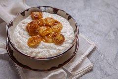 Oatmeal porridge with banana and honey Royalty Free Stock Images
