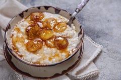 Oatmeal porridge with banana and honey Royalty Free Stock Photo