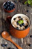 Bowl of oatmeal porridge with blueberry Royalty Free Stock Photo