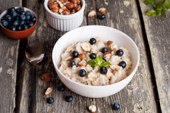 Bowl of oatmeal porridge with blueberry and mint Royalty Free Stock Image