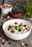 Bowl of oatmeal porridge with blueberry and mint Stock Photos