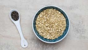Bowl of oatmeal porridge and chia seeds. royalty free stock image