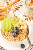 Bowl of oatmeal porridge with green Apple, banana, blueberries, honey and Chia seeds Royalty Free Stock Photo