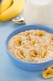 Bowl of oatmeal tablecloth Royalty Free Stock Image