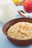 Bowl of oatmeal on tablecloth Stock Photo