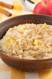 Bowl of oatmeal on tablecloth Royalty Free Stock Image