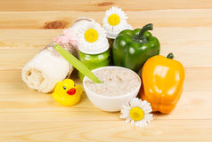 Bowl  oatmeal, vegetable puree, towel on background light wood. Royalty Free Stock Photo