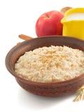 Bowl of oatmeal  on white Royalty Free Stock Photos