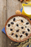 Bowl of oatmeal on wood Royalty Free Stock Image