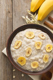 Bowl of oatmeal on wood Royalty Free Stock Images
