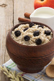 Bowl of oatmeal on wood Stock Photo