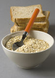 Bowl with oats and bread. Happy breakfast - Bowl with oats and bread Stock Photos