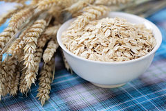 Bowl of oats. Bowl full of oats - healthy eating -food and drink Royalty Free Stock Photos