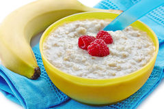 Bowl of oats porridge Stock Image