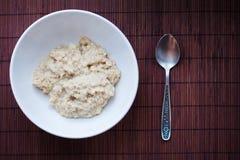 Bowl of oats porridge Stock Photos