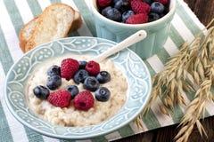 Bowl of oats porridge. Healthy breakfast Stock Image