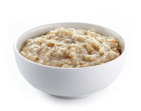 Bowl of oats porridge. On a white background stock image