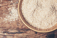 Bowl of oats on table Royalty Free Stock Photography