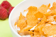 Bowl Of Corn Flakes With Raspberry On Background Royalty Free Stock Images