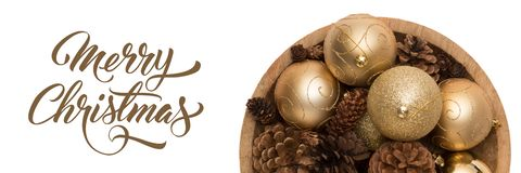Bowl Of Golden Christmas Baubbles And Pine Cones Isolated Over White Background. Golden Christmas Ornaments Banner. Stock Photo