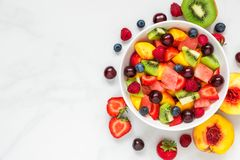 Free Bowl Of Healthy Fresh Fruit Salad On White Marble Background. Healthy Food. Top View Royalty Free Stock Image - 125285156