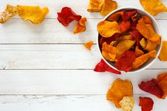Free Bowl Of Healthy Vegetable Chips, Top View With Copy Space On White Wood Royalty Free Stock Image - 110881726