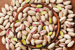 Bowl Of Pistachio Nuts On Wooden Table Top View. Healthy Food And Snack. Royalty Free Stock Photos