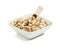 Free Bowl Of Pistachios With Wooden Shovel Stock Image - 17607931