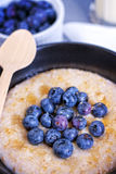 Bowl Of Porridge With Blueberries Stock Photo