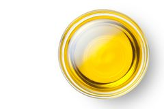 Olive oil. A bowl of olive oil isolated on white background, Top view royalty free stock image