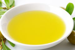 Bowl of olive oil Stock Images