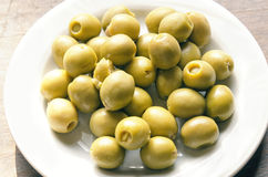 Bowl of olives in the foreground Royalty Free Stock Photos