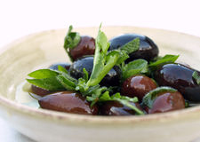 Bowl of olives and herbs Royalty Free Stock Image
