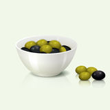 A bowl of olives with shadow and reflection Stock Photo