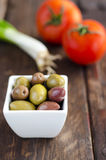 Bowl with olives, tomatoes and green onion Royalty Free Stock Photography