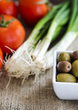 Bowl with olives, tomatoes and green onion royalty free stock photo