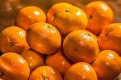 Bowl of oranges on wooden table Royalty Free Stock Photography