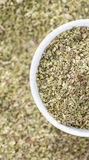 Bowl with Oregano (top view) royalty free stock image