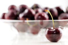 A bowl of an organic fresh cherries royalty free stock image