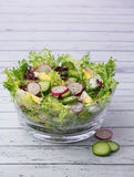 Bowl with organic salad on wooden background Stock Photo