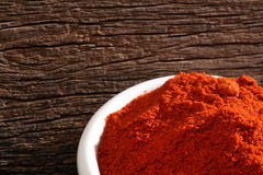 Bowl with paprika. Over a wooden background royalty free stock photography