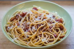 Bowl of pasta all`amatriciana with grated parmesan cheese royalty free stock photos