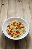 Bowl of Pasta. Curly pasta dish on a rustic wood plank table Stock Photography