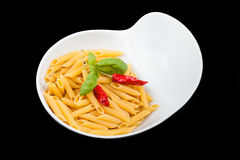Bowl With Pasta Over Black Background Royalty Free Stock Image